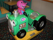 Barney tractor coin-op ride