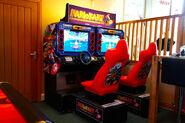 24272-mario-kart-arcade-gp-arcade-machine-in-showroom-dark