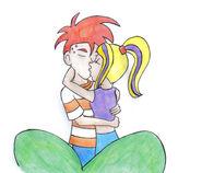 Pocałunek Emi i Fineasza za krzakiem