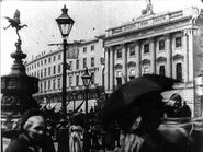 Leisurely Pedestrians, Open Topped Buses and Hansom Cabs with Trotting Horses