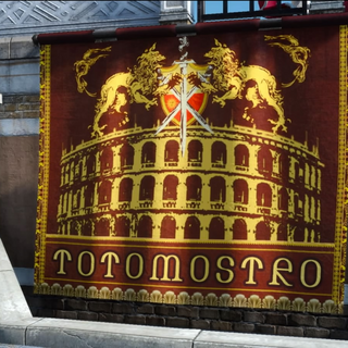 A Totomostro banner hangs along the hallway to Arena Galviano.