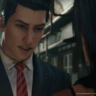 Shinra Middle Manager talks to Tifa.