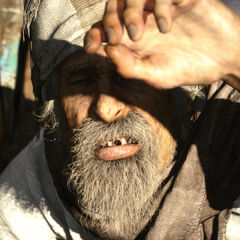 Old man peering at the sun.