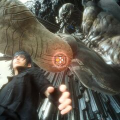 Titan attempts to crush Noctis with his foot in the <i>Trial of Titan</i> demo.