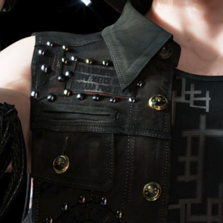 Close-up of Prompto's vest.