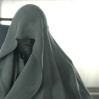 Rufus covered by a white sheet in <i>Advent Children</i>.