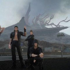 The party posing for a photo in front of the volcano.