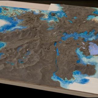 Аккордо на ранней версии карты мира, расположен в бухте справа.