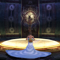 Yuna prays in the Chamber of the Fayth.
