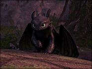 Toothless watching his drawing