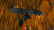 Toothless flying across field