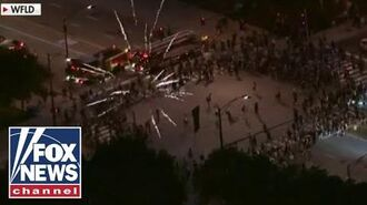 18 Chicago police officers injured in 'ambush' during statue protest