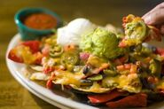 13052663-nachos-with-cheese-guacamole-and-sour-cream