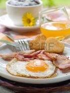 7685550-bacon-eggs-toast-orange-juice-and-coffee-for-breakfast