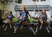 The Seattle Seahawks cheerleaders, the Sea Gals, perform for Sailors and Marines aboard the amphibious assault ship USS