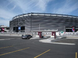 The exterior of an American football stadium, which is silver.