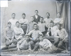 """Portrait of College Football Team, The """"Pirates,"""" in Partial Uniform, and with Man in Business Suit 1879"""
