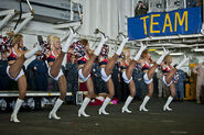 Seattle Seahawks cheerleaders, the Sea Gals, perform a dance routine for Sailors and Marines aboard the amphibious assau