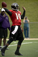 A picture of Troy Smith throwing a pass.