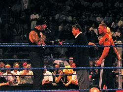 Undertaker, Vince McMahon, Brock Lesnar, & Sable in a WWE ring