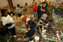 800px-US Navy 090219-N-7544A-076 Sailors sort through food items checking expiration dates while volunteering at The Food Bank of Southeastern Virginia