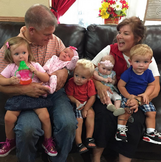 Gil and kelly and five grandchildren