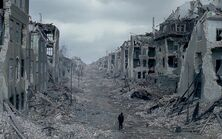 Man-walking-through-destroyed-city