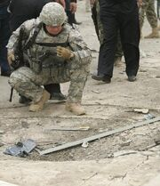 A-us-soldier-inspects-the-site-of-a-car-bomb-attack-in-kirkuk