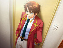 Keita standing against a door