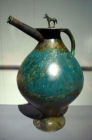 Spouted bronze flagon