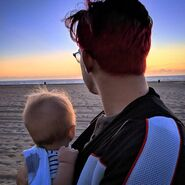 Ollie and his dad on the beach