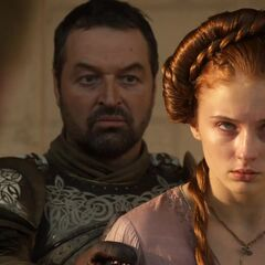 Joffrey zwingt Sansa den Kopf ihres toten Vaters anzusehen.