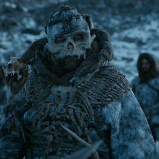 Wildlings who live up in the Frostfang Mountains decorate themselves with bones.