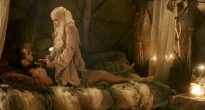 Khal and Dany in bed