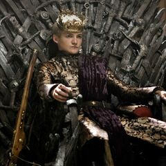 King Joffrey Baratheon, First of His Name, sits on the Iron Throne in