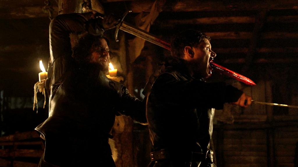 Jon Snow (Kit Harrington) brutally dispatches Karl (Burn Gorman) but just misses seeing his brother Bran Stark. (Isaac Hempstead Wright).
