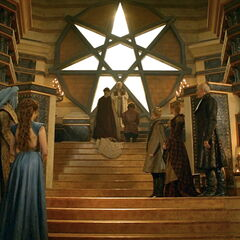 Tyrion Lannister and Sansa with Tywin Lannister, Cersei Lannister, Joffrey Baratheon, Lord Varys, Grand Maester Pycelle, Margaery Tyrell, Lady Olenna Tyrell and Loras Tyrell in