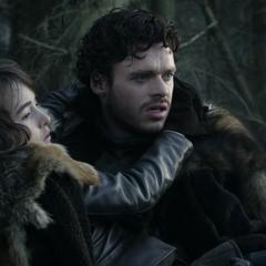 Robb ratuje Brana z zasadzki dzikich.