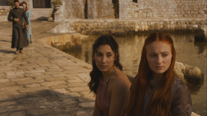 Shae with sansa as petyr approaches