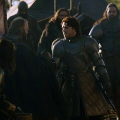 The Young Wolf walks through the Stark camp in