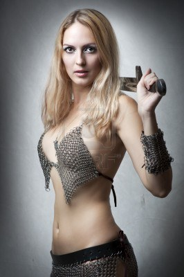 File:10906164-portrait-of-young-sexy-model-woman-warrior-with-sword-in-seductive-armourlooking-at-camera-joan-of-a.jpg