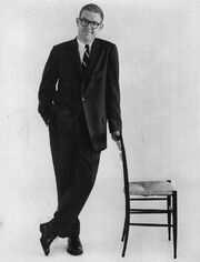 Stan Freberg leans on chair