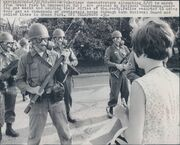 Anti-War Protester Faces Off With National Guardsmen Wearing M9A1 Gas Masks