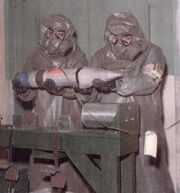 M9A1 Gas Masks With Toxicological Agent Protective (T.A.P.) Hoods And Aprons