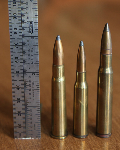 A six and a half times fifty milometer cartridge with ruler 3 08 Enfield and 30 06 Springfield for comparison