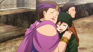 Cicero's wife huggs Kurobayashi while being releaced from Basson Prison Anime episode 23