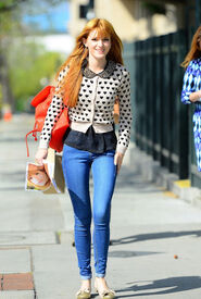 Bella-thorne-poka-dot-top-with-red-bag
