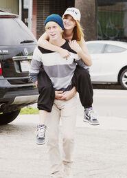 Bella-thorne-piggyback-ride-(2)