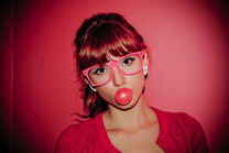 Bella with glasses and bubblegum