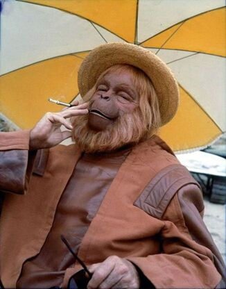 Dr-Zaius-Smoking-a-Cigarette-Planet-of-the-Apes-Behind-the-Scenes-Photo